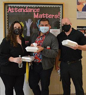 administrators-posing-with-the-may-teacher-of-the-month