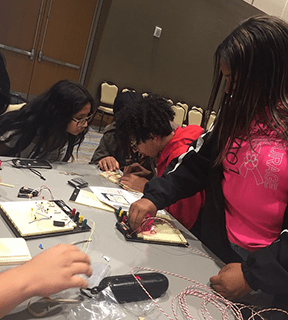 Students work on a project at a table