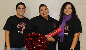 Staff members pose together holding spirit items