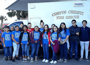 Students pose with Corpus Christi Fire Rescue truck