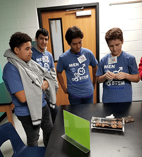 Men in STEM group works on a project