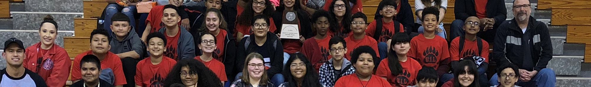 Junior high uil participants sitting together after earning second place at annual event.