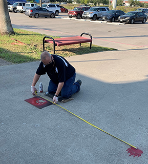 custodian working on sidewalk