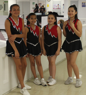 Four students in dance costumes