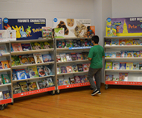 male student shopping at the book fair