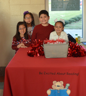 Four students at a reading promotional event