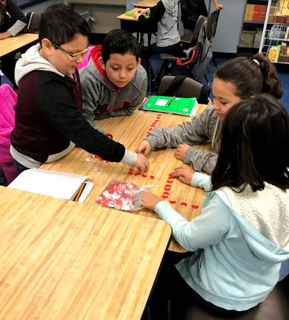 Students working on an activity at a table