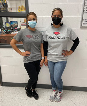 two-teachers-wearing-college-shirts-for-spirit-week