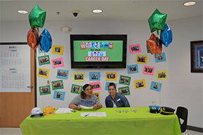 Staff sitting at the career day welcome table