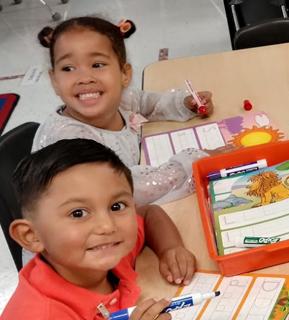 Two smiling kindergarten students