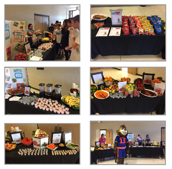 cafeteria worker with display of healthy foods