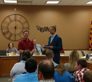 Mark Goodman receiving appreciation from board