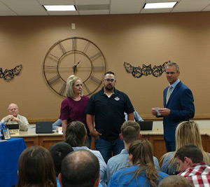 Kendall and Molli Bryant receiving appreciation from board