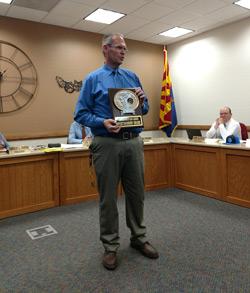 Mr. Solomon displaying sportsmanship award