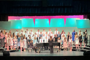 Choir performing on stage for the spring choir concert
