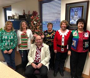 staff members in Christmas sweaters