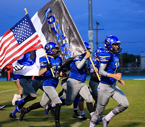 football players running with flags