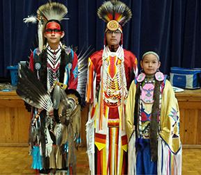 three students in native american attire