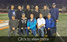 Men from the 1993 3A State Football Championship team pose on a football field