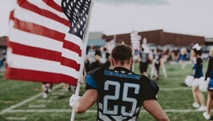 football player with the American flag