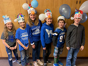 Students with hats for the 100th day of school