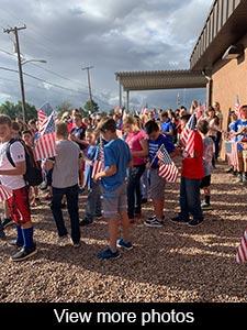 View more photos of flag raising