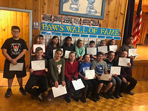 PAWS Citizenship winners hold their certificates and pose together