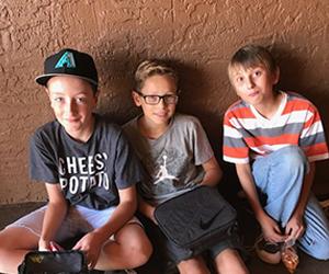 three boys sitting