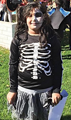 Spooky Story Contest Winner in her skeleton costume