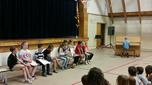 students at school piano recital