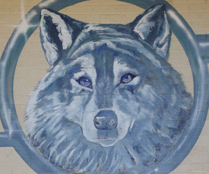 Lobos logo painted on a brick wall