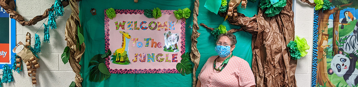 Principal Muder in front of Welcome to the Jungle 2020-2021 theme