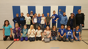 Students and teachers wearing 100 things for the 100th day of school