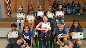 Million Word Readers pose with their certificates