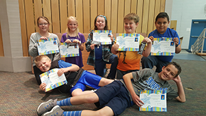 Million Word Readers pose together with their certificates
