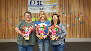 Office ladies and principal Ms. Debbie Muder pose with their gifts
