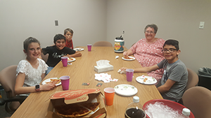 April outstanding students eat pizza with Principal Debbie Muder