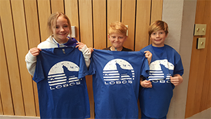 PAWS T-Shirt Drawing Winners pose together with their t-shirts