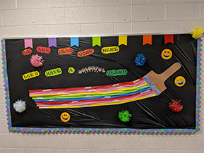 We are glad you're here, let's have a colorful year bulletin board
