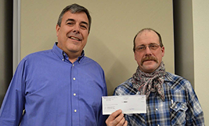 Superintendent Bruce Thorn and Board Chairman Kelly Gardner pose with the grant check