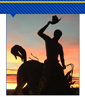 statue of bucking bronco at sunrise