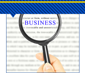 a magnifying glass examining the work business