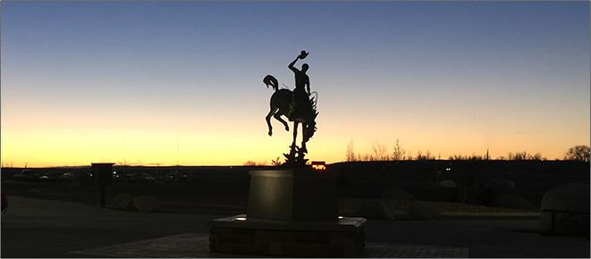 Wrangler statue at sunrise