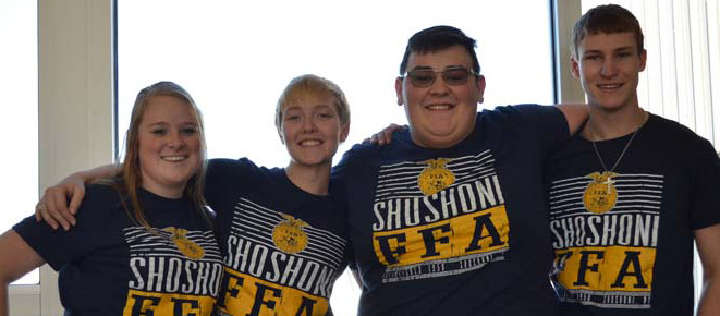 4 students with FFA shirts smiling