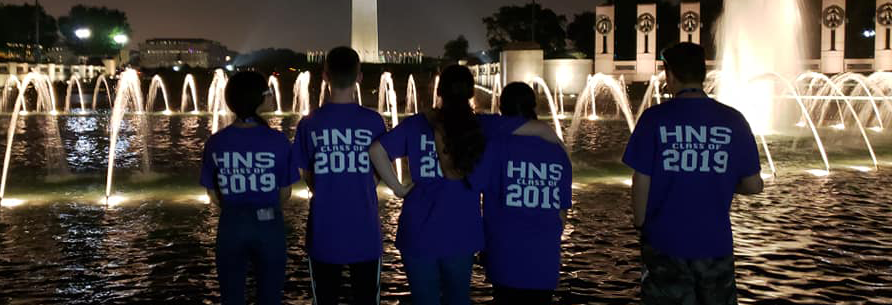 Students at Washington DC looking at a fountain and lights