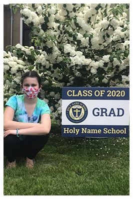 student in front of sign saying class of 2020