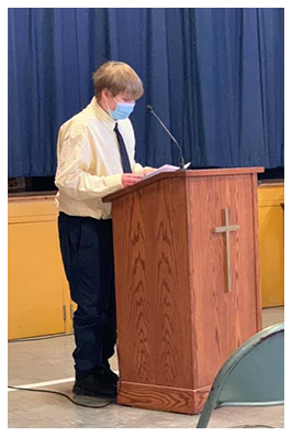 Male student speaking at pulpit