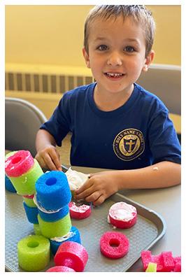 little boy holding a kitten