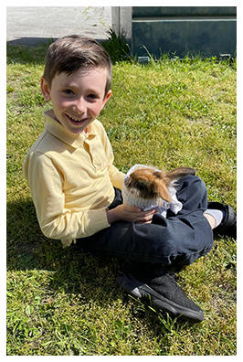 School girl sitting outside with face mask on