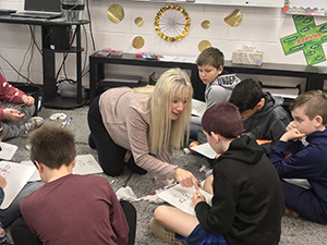 Teacher working with her fourth grade students in groups